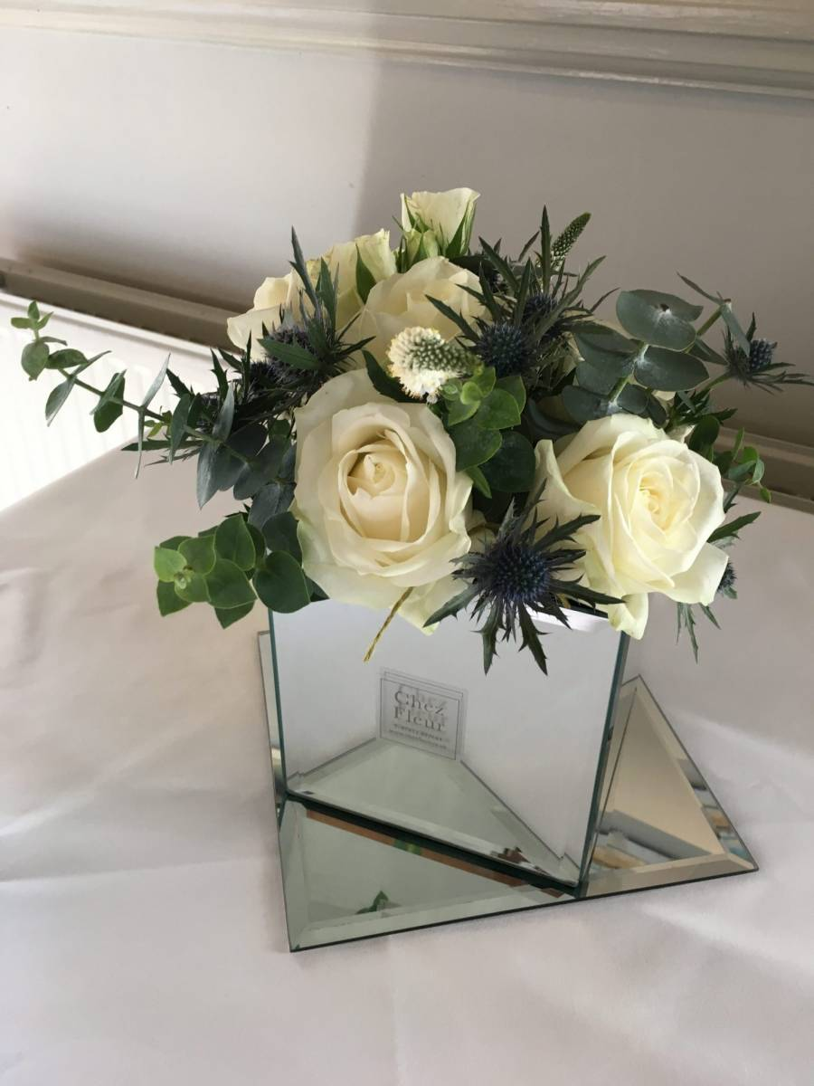 Stylish mirrror cube with avalanche roses, eryngium & eucalyptus