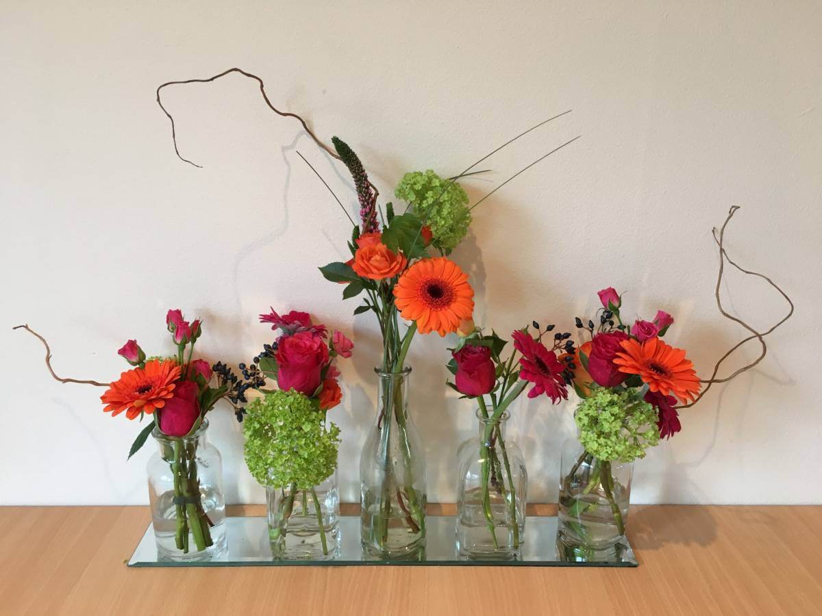 Bright & cheerful germini with craspedia & viburnum opulus for top table